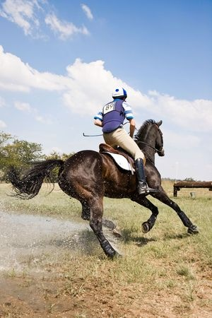 XC rider cantering away